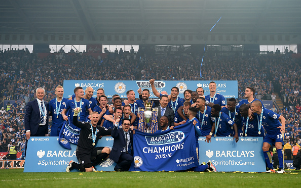 LEICESTER, ENGLAND - MAY 07:  Leicester City players celebrate the season champions with the Premier League Trophy after the Barclays Premier League match between Leicester City and Everton at The King Power Stadium on May 7, 2016 in Leicester, United Kingdom.  (Photo by Michael Regan/Getty Images)