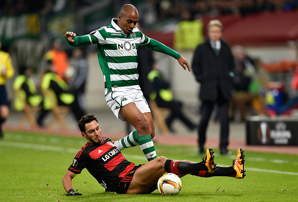 LEVERKUSEN, GERMANY - FEBRUARY 25: Joao Mario of Sporting Lisbon and Hakan Calhanoglu of Bayer Leverkusen compete for the ball during the UEFA Europa League round of 32 second leg match between Bayer Leverkusen and Sporting Lisbon at BayArena on February 25, 2016 in Leverkusen, Germany.  (Photo by Dennis Grombkowski/Bongarts/Getty Images)