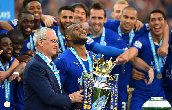 LEICESTER, ENGLAND - MAY 07:  Captain Wes Morgan and manager Claudio Ranieri of Leicester City prepare to lift the Premier League Trophy after the Barclays Premier League match between Leicester City and Everton at The King Power Stadium on May 7, 2016 in Leicester, United Kingdom.  (Photo by Shaun Botterill/Getty Images)