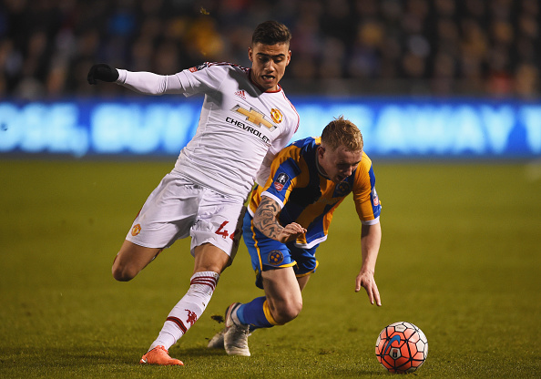 SHREWSBURY, ENGLAND - FEBRUARY 22:  Jack Grimmer of Shrewsbury Town battles with Andreas Pereira of Manchester United during the Emirates FA Cup fifth round match between Shrewsbury Town and Manchester United at Greenhous Meadow on February 22, 2016 in Shrewsbury, England.  (Photo by Laurence Griffiths/Getty Images)