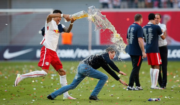 LEIPZIG, GERMANY - MAY 08:  Davie Selke (L) of Leipzig showers his head coach Ralf Rangnick with beer while celebrating promotion to the first Bundesliga after the Second Bundesliga match between RB Leipzig and Karlsruher SC at Red Bull Arena on May 08, 2016 in Leipzig, Saxony.  (Photo by Boris Streubel/Bongarts/Getty Images)