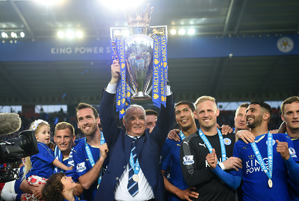 LEICESTER, ENGLAND - MAY 07:  Claudio Ranieri Manager of Leicester City lifts the Premier League Trophy as players and staffs celebrate the season champion after the Barclays Premier League match between Leicester City and Everton at The King Power Stadium on May 7, 2016 in Leicester, United Kingdom.  (Photo by Michael Regan/Getty Images)
