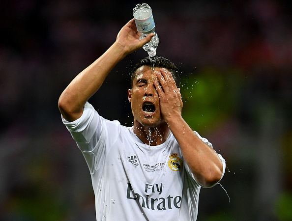 MILAN, ITALY - MAY 28:  Cristiano Ronaldo of Real Madrid takes a refreshment during the UEFA Champions League Final match between Real Madrid and Club Atletico de Madrid at Stadio Giuseppe Meazza on May 28, 2016 in Milan, Italy.  (Photo by Laurence Griffiths/Getty Images)