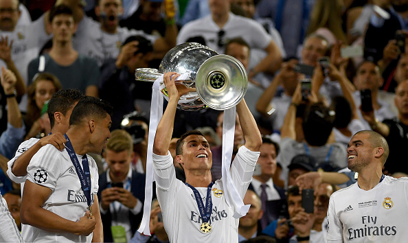 MILAN, ITALY - MAY 28:  Cristiano Ronaldo of Real Madrid lifts the Champions League trophy after the UEFA Champions League Final match between Real Madrid and Club Atletico de Madrid at Stadio Giuseppe Meazza on May 28, 2016 in Milan, Italy.  (Photo by Laurence Griffiths/Getty Images)