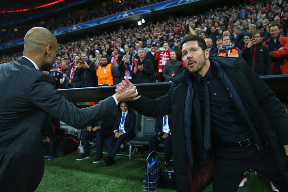 MUNICH, GERMANY - MAY 03:  Josep Guardiola manager of Bayern Munich and Diego Simeone head coach of Atletico Madrid shake hands prior to the UEFA Champions League semi final second leg match between FC Bayern Muenchen and Club Atletico de Madrid at Allianz Arena on May 3, 2016 in Munich, Germany.  (Photo by Alexander Hassenstein/Bongarts/Getty Images)