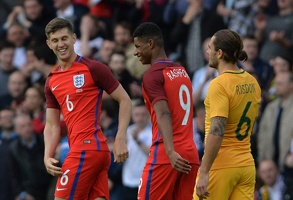 SUNDERLAND, ENGLAND - MAY 27: John Stones (L), of England  celebrate with goal scorer Marcus Rashford of England after he scored in the first half during the International Friendly match between England and Australia at Stadium of Light on May 27, 2016 in Sunderland, England. (Photo by Mark Runnacles/Getty Images)