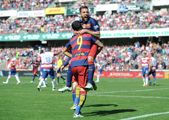 GRANADA, SPAIN - MAY 14:  Luis Suarez of Barcelona celebrates scoring his team's first goal with his team mate Jordi Alba during the La Liga match between Granada and Barcelona at Estadio Nuevo Los Carmenes on May 14, 2016 in Granada, Spain.  (Photo by Denis Doyle/Getty Images)