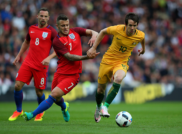 SUNDERLAND, ENGLAND - MAY 27:  Robbie Kruse of Australia holds off the challenge of Jack Wilshere of England during the International Friendly match between England and Australia at Stadium of Light on May 27, 2016 in Sunderland, England.  (Photo by Alex Livesey/Getty Images)