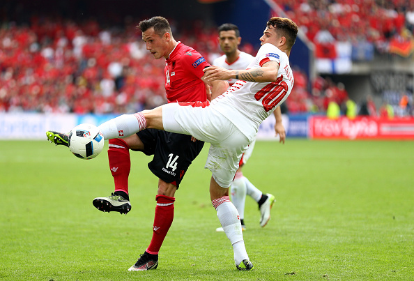 LENS, FRANCE - JUNE 11:  Taulant Xhaka of Albania and Granit Xhaka of Switzerland compete for the ball during the UEFA EURO 2016 Group A match between Albania and Switzerland at Stade Bollaert-Delelis on June 11, 2016 in Lens, France.  (Photo by Paul Gilham/Getty Images)