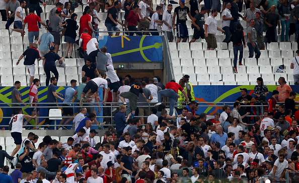 MARSEILLE, FRANCE - JUNE 11:  Fans clash after the UEFA EURO 2016 Group B match between England and Russia at Stade Velodrome on June 11, 2016 in Marseille, France.  (Photo by Lars Baron/Getty Images)