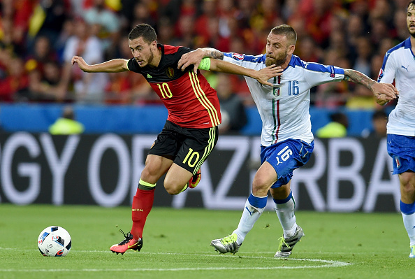 Daniele De Rossi of Italy (R) and Eden Hazard of Belgium Compete for the ball during the UEFA EURO 2016 Group E match between Belgium and Italy at Stade des Lumieres on June 13, 2016 in Lyon, France.
