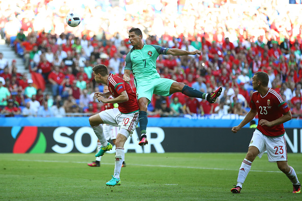 LYON, FRANCE - JUNE 22: Cristiano Ronaldo of Portugal and Richard Guzmics of Hungary compete for the ball during the UEFA EURO 2016 Group F match between Hungary and Portugal at Stade des Lumieres on June 22, 2016 in Lyon, France.  (Photo by Clive Brunskill/Getty Images)
