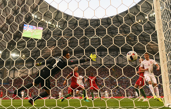 MARSEILLE, FRANCE - JUNE 30:  Rui Patricio (1st L) of Portugal dives in vain as Robert Lewandowski (3rd L) of Poland scores the opening goal during the UEFA EURO 2016 quarter final match between Poland and Portugal at Stade Velodrome on June 30, 2016 in Marseille, France.  (Photo by Laurence Griffiths/Getty Images)
