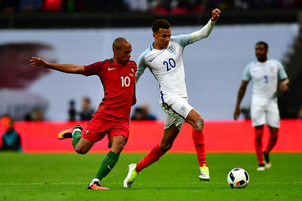 LONDON, ENGLAND - JUNE 02:  Dele Alli of England holds off Joao Mario of Portugal during the international friendly match between England and Portugal at Wembley Stadium on June 2, 2016 in London, England.  (Photo by Dan Mullan/Getty Images)