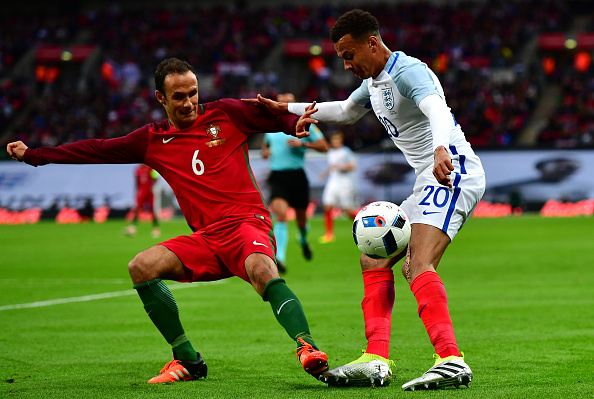 LONDON, ENGLAND - JUNE 02:  Dele Alli of England takes on Ricardo Carvalho of Portugal during the international friendly match between England and Portugal at Wembley Stadium on June 2, 2016 in London, England.  (Photo by Dan Mullan/Getty Images)