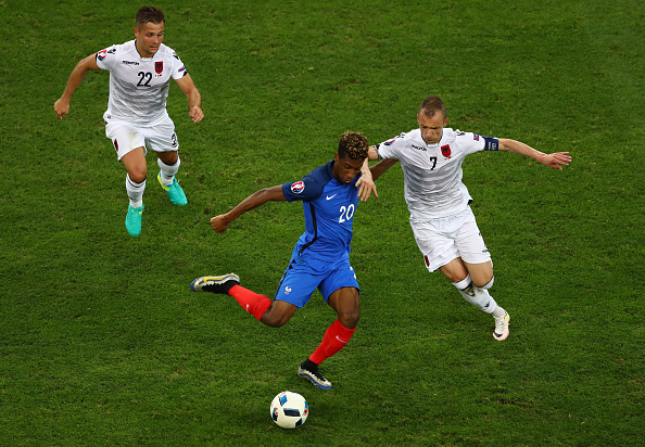 MARSEILLE, FRANCE - JUNE 15:  Kingsley Coman of France takes on Ansi Agolli of Albania during the UEFA EURO 2016 Group A match between France and Albania at Stade Velodrome on June 15, 2016 in Marseille, France.  (Photo by Lars Baron/Getty Images)