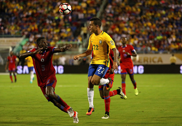 ORLANDO, FL - JUNE 08: Philippe Coutinho #22 of Brazil and Romain Genevois #5 of Haiti fight for the ball during a Group B match of the 2016 Copa America Centenario at Camping World Stadium on June 8, 2016 in Orlando, Florida.  (Photo by Mike Ehrmann/Getty Images)