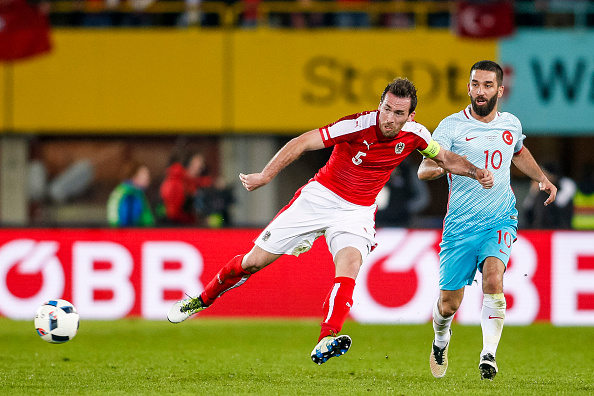 VIENNA, AUSTRIA - MARCH 29:  Christian Fuchs of Austria (L) competes for the ball with Arda Turan of Turkey during the international friendly match between Austria and Turkey at Ernst-Happel-Stadium on March 29, 2016 in Vienna, Austria. (Photo by Christian Hofer/Getty Images)