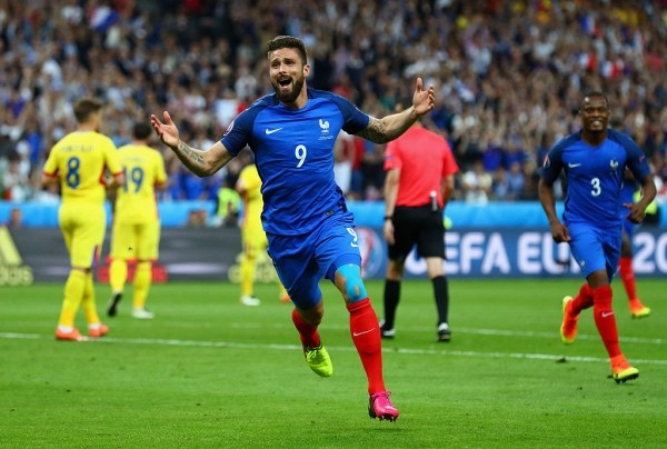 PARIS, FRANCE - JUNE 10:  Olivier Giroud of France celebrates scoring his team's first goal during the UEFA Euro 2016 Group A match between France and Romania at Stade de France on June 10, 2016 in Paris, France.  (Photo by Clive Rose/Getty Images)