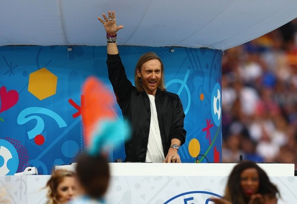 PARIS, FRANCE - JUNE 10:  DJ David Guetta performs during the opening ceremony during the UEFA Euro 2016 Group A match between France and Romania at Stade de France on June 10, 2016 in Paris, France.  (Photo by Clive Rose/Getty Images)