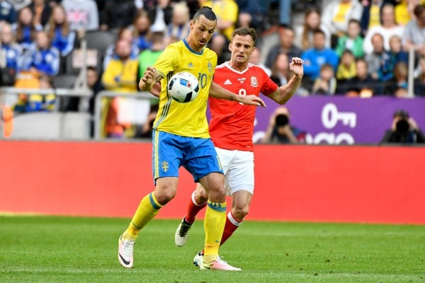SOLNA, SWEDEN - JUNE 05: Zlatan Ibrahimovic of Sweden and Andy King of Wales during the international friendly between Sweden and Wales at Friends Arena on June 5, 2016 in Solna, Sweden. (Photo by Mikael Sjoberg/Ombrello/Getty Images)