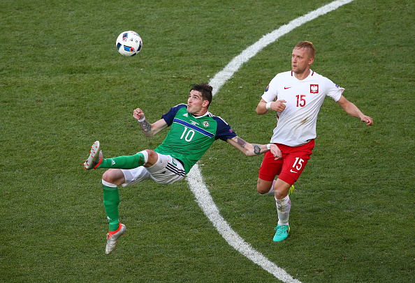 NICE, FRANCE - JUNE 12:  Kyle Lafferty (L)of Northern Ireland attempts an overhead kick during the UEFA EURO 2016 Group C match between Poland and Northern Ireland at Allianz Riviera Stadium on June 12, 2016 in Nice, France.  (Photo by Alex Livesey/Getty Images)