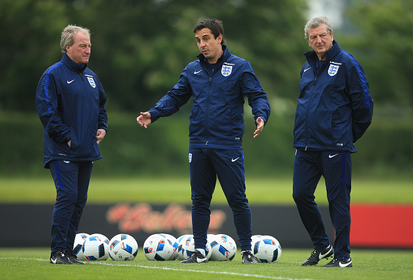 ST ALBANS, ENGLAND - MAY 30:  Manager of England, Roy Hodgson, Assistant Manager of England, Gary Neville and Ray Lewington look on during an England training session at London Colney on May 30, 2016, near St Albans, England  (Photo by Ben Hoskins/Getty Images)