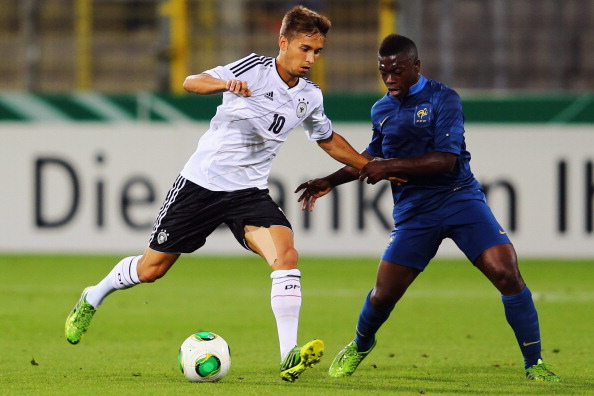 FREIBURG IM BREISGAU, GERMANY - AUGUST 13: Moritz Leitner (L) of Germany is challenged by Nampalys Mendy of France during the U21 match between Germany and France on August 13, 2013 in Freiburg im Breisgau, Germany.  (Photo by Alex Grimm/Bongarts/Getty Images)