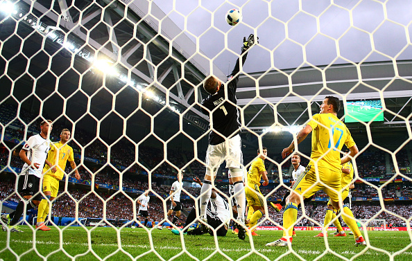 LILLE, FRANCE - JUNE 12:  Manuel Neuer of Germany makes a save during the UEFA EURO 2016 Group C match between Germany and Ukraine at Stade Pierre-Mauroy on June 12, 2016 in Lille, France.  (Photo by Clive Mason/Getty Images)