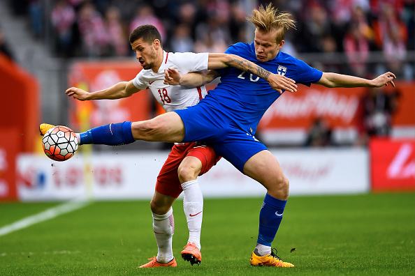WROCLAW, POLAND - MARCH 26: (L) Pawel Wszolek of Poland fights for the ball with (R) Joel Pohjanpalo of Finland during the international friendly soccer match between Poland and Finland at the Municipal Stadium on March 26, 2016 in Wroclaw, Poland. (Photo by Adam Nurkiewicz/Getty Images)