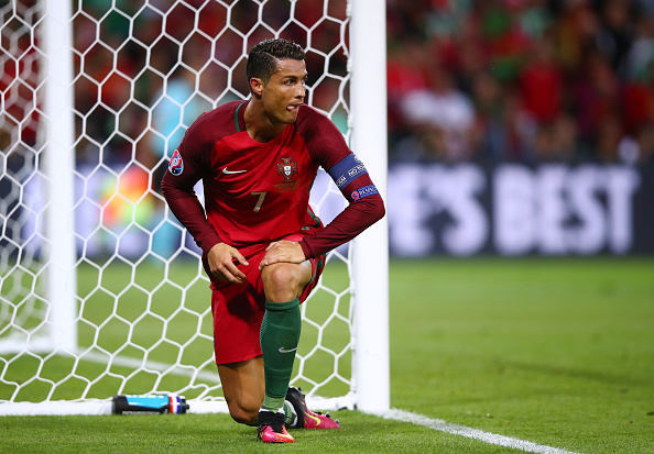 SAINT-ETIENNE, FRANCE - JUNE 14: Cristiano Ronaldo of Portugal reacts during the UEFA EURO 2016 Group F match between Portugal and Iceland at Stade Geoffroy-Guichard on June 14, 2016 in Saint-Etienne, France.  (Photo by Clive Brunskill/Getty Images)