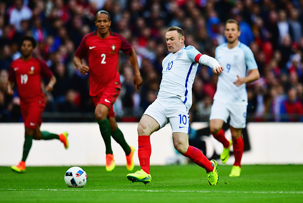 LONDON, ENGLAND - JUNE 02:  Wayne Rooney of England attempts to beat the Portugal defence during the international friendly match between England and Portugal at Wembley Stadium on June 2, 2016 in London, England.  (Photo by Dan Mullan/Getty Images)