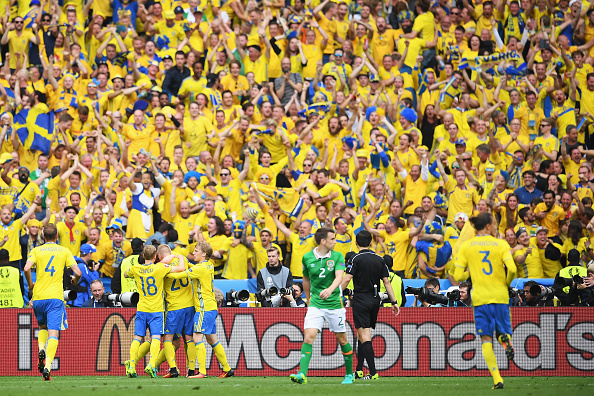 PARIS, FRANCE - JUNE 13: Sweden players celebrate their team's first goal in front of their supporters during the UEFA EURO 2016 Group E match between Republic of Ireland and Sweden at Stade de France on June 13, 2016 in Paris, France.  (Photo by Matthias Hangst/Getty Images)
