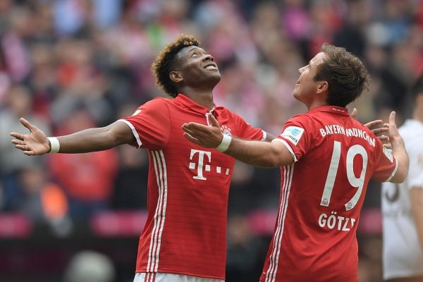MUNICH, GERMANY - MAY 14:  Mario Goetze (R) of Bayern Muenchen celebrates scoring his team's third goal with his team mate David Alaba (L) during the Bundesliga match between FC Bayern Muenchen and Hannover 96 at Allianz Arena on May 14, 2016 in Munich, Germany.  (Photo by Matthias Hangst/Bongarts/Getty Images)