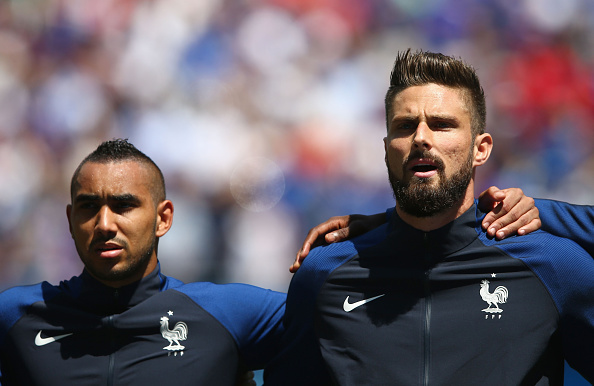 LYON, FRANCE - JUNE 26: Dimitri Payet (L) and Olivier Giroud (R) of France line up for the national anthem prior to the UEFA EURO 2016 round of 16 match between France and Republic of Ireland at Stade des Lumieres on June 26, 2016 in Lyon, France.  (Photo by Alex Livesey/Getty Images)