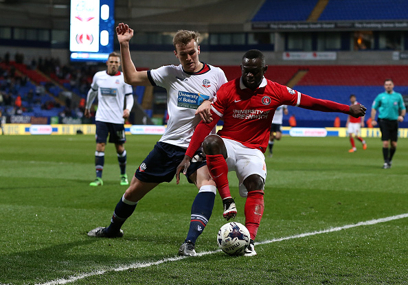 BOLTON, ENGLAND - APRIL 19:  Rob Holding of Bolton Wanderers battles with Igor Vetokele of Charlton Athletic during the Sky Bet Championship match between Bolton Wanderers and Charlton Athletic at Reebok Stadium on April 19, 2016 in Bolton, United Kingdom.  (Photo by Jan Kruger/Getty Images)