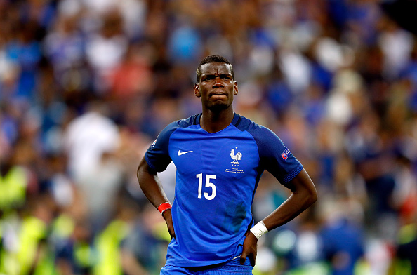 PARIS, FRANCE - JULY 10:  Paul Pogba of France shows his dejection after his team's 0-1 defeat in the UEFA EURO 2016 Final match between Portugal and France at Stade de France on July 10, 2016 in Paris, France.  (Photo by Clive Rose/Getty Images)