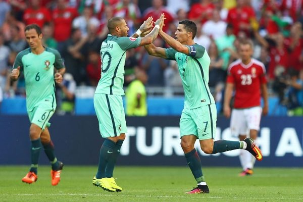 LYON, FRANCE - JUNE 22:  Cristiano Ronaldo (R) of Portugal celebrates scoring his team's third goal with his team mate Ricardo Quaresma (L) during the UEFA EURO 2016 Group F match between Hungary and Portugal at Stade des Lumieres on June 22, 2016 in Lyon, France.  (Photo by Julian Finney/Getty Images)