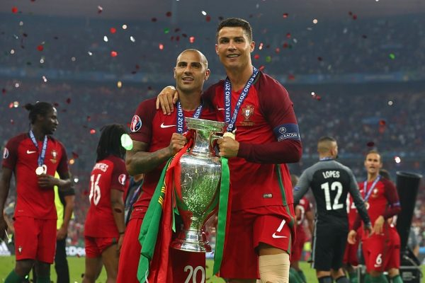 PARIS, FRANCE - JULY 10:  Cristiano Ronaldo (R) and Ricardo Quaresma (L) and Portugal pose for photographs with the Henri Delaunay trophy to celebrate after their 1-0 win against France in the UEFA EURO 2016 Final match between Portugal and France at Stade de France on July 10, 2016 in Paris, France.  (Photo by Lars Baron/Getty Images)