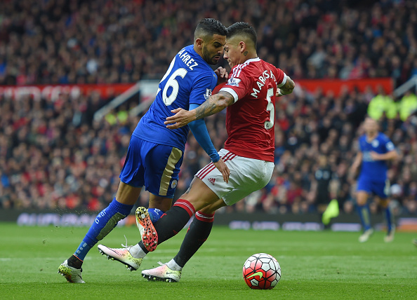 MANCHESTER, ENGLAND - MAY 01:  Marcos Rojo of Manchester United challenges Riyad Mahrez of Leicester City in the penalty area during the Barclays Premier League match between Manchester United and Leicester City at Old Trafford on May 1, 2016 in Manchester, England.  (Photo by Michael Regan/Getty Images)