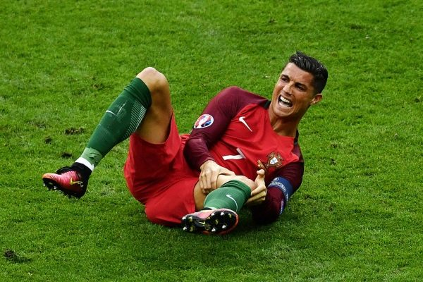 PARIS, FRANCE - JULY 10: Cristiano Ronaldo of Portugal lies injured during the UEFA EURO 2016 Final match between Portugal and France at Stade de France on July 10, 2016 in Paris, France.  (Photo by Dan Mullan/Getty Images)