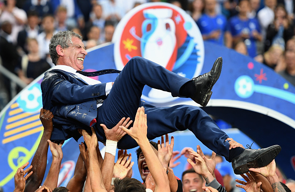 PARIS, FRANCE - JULY 10:  Fernando Santos manager of Portugal is thrown into the air by his players after his side win 1-0 against France during the UEFA EURO 2016 Final match between Portugal and France at Stade de France on July 10, 2016 in Paris, France.  (Photo by Laurence Griffiths/Getty Images)