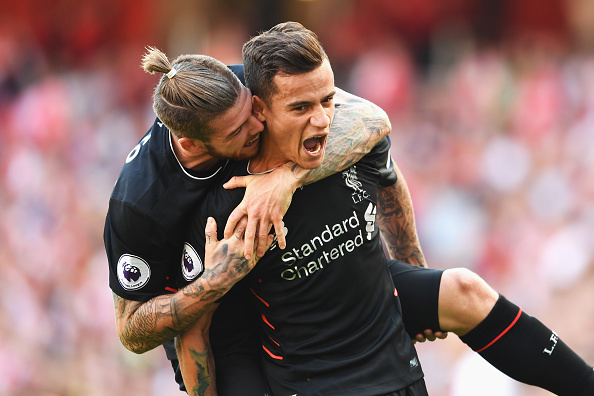 LONDON, ENGLAND - AUGUST 14:  Philippe Coutinho of Liverpool celebrates scoring his free kick with Alberto Moreno during the Premier League match between Arsenal and Liverpool at Emirates Stadium on August 14, 2016 in London, England.  (Photo by Mike Hewitt/Getty Images)