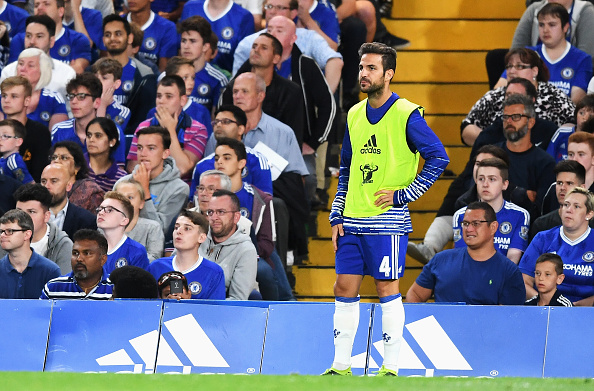 LONDON, ENGLAND - AUGUST 15: Cesc Fabregas of Chelsea looks on from the sidelines during the Premier League match between Chelsea and West Ham United at Stamford Bridge on August 15, 2016 in London, England.  (Photo by Michael Regan/Getty Images)