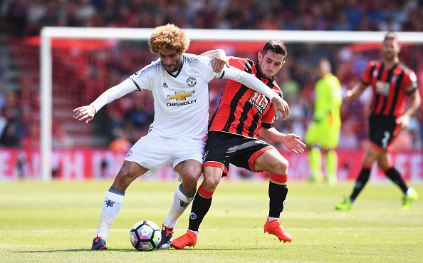 BOURNEMOUTH, ENGLAND - AUGUST 14: Marouane Fellaini of Manchester United is challenged by Lewis Cook of AFC Bournemouth during the Premier League match between AFC Bournemouth and Manchester United at Vitality Stadium on August 14, 2016 in Bournemouth, England.  (Photo by Stu Forster/Getty Images)