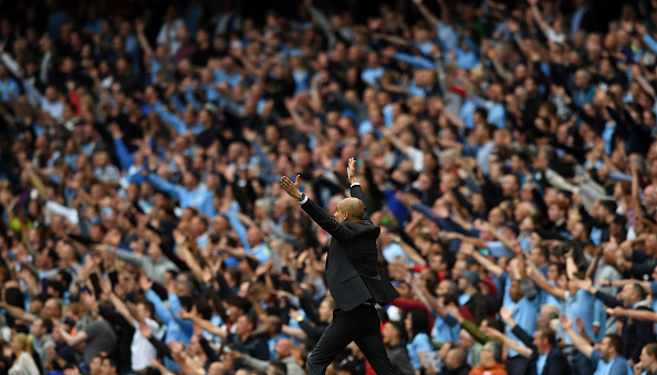 MANCHESTER, ENGLAND - AUGUST 13:  Manchester City manager Pep Guardiola and the fans react during the Premier League match between Manchester City and Sunderland at Etihad Stadium on August 13, 2016 in Manchester, England.  (Photo by Stu Forster/Getty Images)