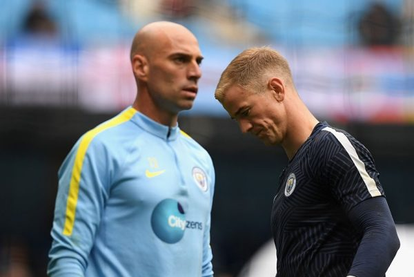 MANCHESTER, ENGLAND - AUGUST 13:  Manchester City goalkeepers Willy Caballero (l) and Joe Hart look on during the warm up before the Premier League match between Manchester City and Sunderland at Etihad Stadium on August 13, 2016 in Manchester, England.  (Photo by Stu Forster/Getty Images)