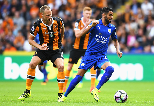 HULL, ENGLAND - AUGUST 13: Riyad Mahrez of Leicester City takes the ball away from David Meyler of Hull City during the Premier League match between Hull City and Leicester City at KCOM Stadium on August 13, 2016 in Hull, England.  (Photo by Michael Regan/Getty Images)