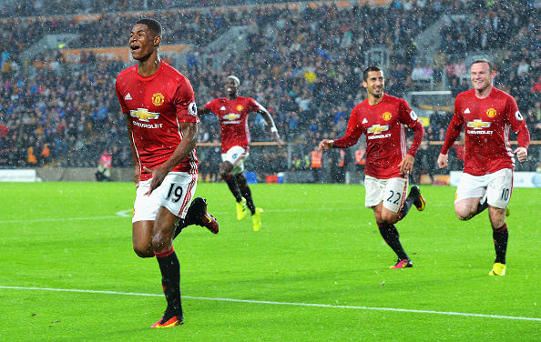 HULL, ENGLAND - AUGUST 27: Marcus Rashford of Manchester United celebrates scoring his sides first goal during the Premier League match between Hull City and Manchester United at KCOM Stadium on August 27, 2016 in Hull, England.  (Photo by Mark Runnacles/Getty Images)