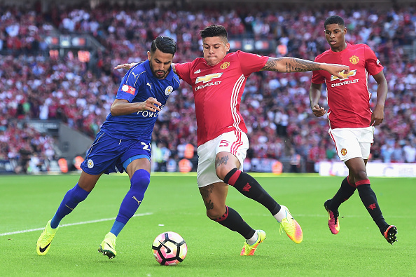 LONDON, ENGLAND - AUGUST 07: Marcos Rojo of Manchester United attempts to tackle Riyad Mahrez of Leicester City during The FA Community Shield match between Leicester City and Manchester United at Wembley Stadium on August 7, 2016 in London, England.  (Photo by Alex Broadway/Getty Images)